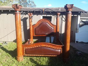 King canopy bed frame with twisted iron leather is peeling a little will take 680 negotiable for Sale in Houston, TX