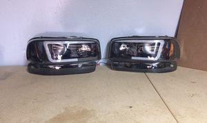 99-2006 Sierra Yukon Headlights Black for Sale in Grand Prairie, TX