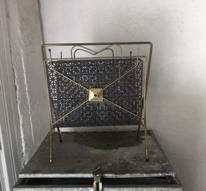 Mid century magazine rack. Gold/black metal for Sale in Grand Rapids, MI