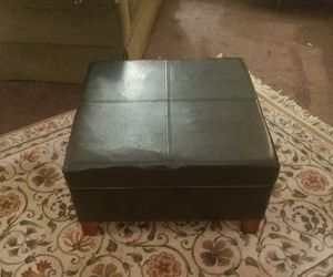 Ottoman with storage... small burn hole in the top barely noticeable leather material for Sale in Cleveland, OH