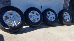 Awesome condition jeep wrangler wheels with michelin 245 75 R17 new tires for Sale in Spanaway, WA