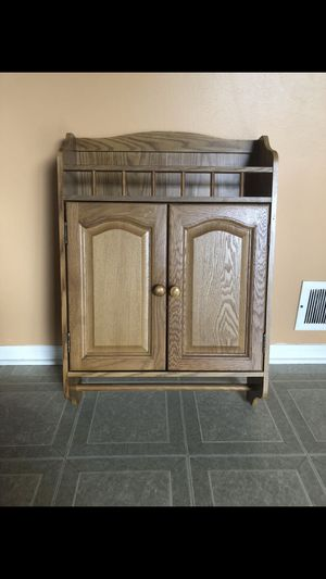 Marc's solid wood bathroom cabinet for Sale in Shelby charter Township, MI