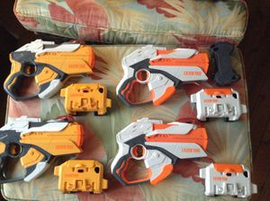Hasbro Nerf Laser Tag Guns w/ iPhone 4/ iPod Holders and Skins for Sale in Stuart, FL