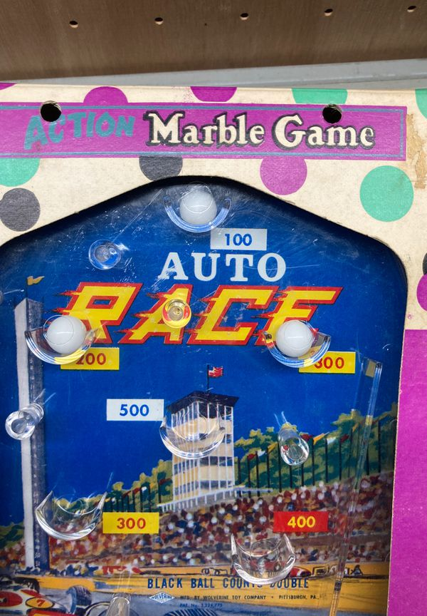 Hand-held ACTION Marble Game