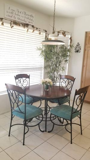 Wrought Iron leg and wooden top dining table and 4 new reupholstered chairs /dining room kitchen room set for Sale in Chino Hills, CA