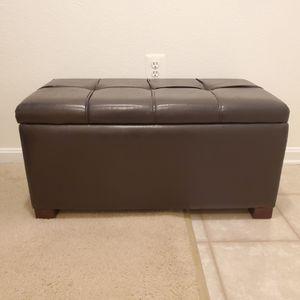 Dark brown/black storage ottoman for Sale in Rockville, MD