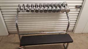 Universal Dumbbell weight set with attached bench. for Sale in Dallas, TX