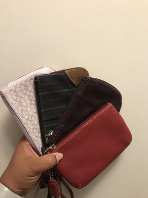 Set of 4 Coach wristlets- used like new for Sale in Baltimore, MD