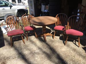 Five piece dining room set table and four chairs with attached cushions solid and $110 for Sale in Varna, IL