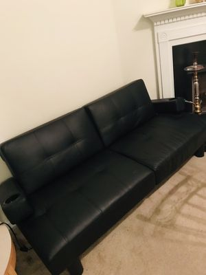 Black leather futon with movable cup holder arm for Sale in Norcross, GA