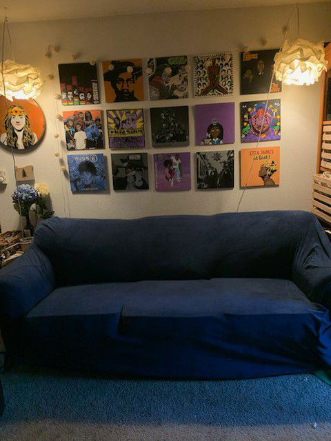 Comfy couch with pull out bed with $60 blue couch cover included