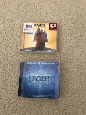 Lot of 2 Disney Frozen & Peanuts Movie CD's - 1 sealed, 1opened for Sale in Waukesha, WI