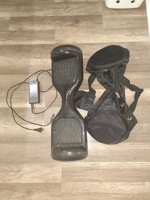 Hoverboard charger and bag to carry. for Sale in Fort Lauderdale, FL