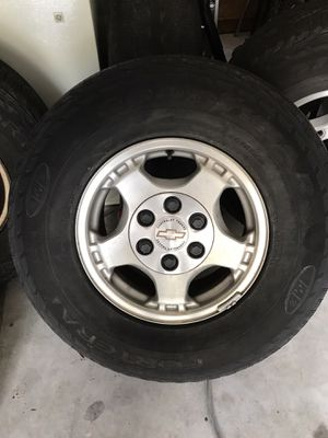 Chevy Rims and tires set of 4 for Sale in Kissimmee, FL