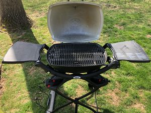Weber q1200 camping grill with folding roller stand and accessories for Sale in Falls Church, VA