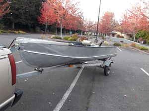 14 ft aluminum boat with ez loader trailer for Sale in Seattle, WA