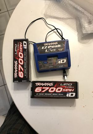 Traxxas Xmaxx 2 batteries 4s 6700mah and charger EZ-peak live for Sale in North Providence, RI