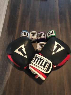 Women's Title boxing gloves - lightly used. 5 never used hand wraps. for Sale in Fort Worth, TX