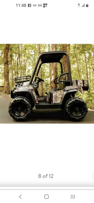 Realtree 24 Volt UTV Powered Ride-On with Custom Realtree Graphics and Working Headlights for Sale in Riverside, CA