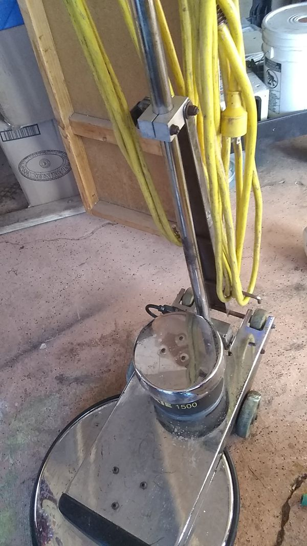 A waxy 1500 floor scrubber in good condition floor buffer with a 5 gallon bucket of wax asking $450 or best offer