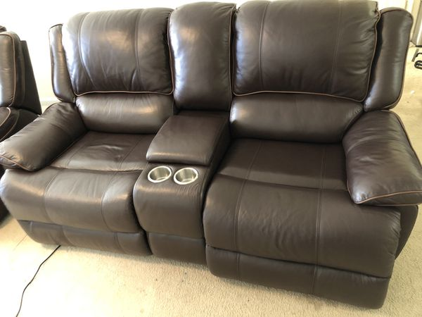 Leather sofa plus love seat with power recliners( 15 months old)