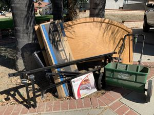 "Oak queen headboard & bed frame, lawn seed spreader, delta faucet brand new, 40"" samsung flat screen tv mount never used - FREE, must pick up & take for Sale in Moreno Valley, CA"