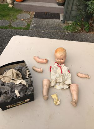 Very old antique doll also extra arm for other doll very old still have the original stuffing and fabric just need somebody to put it back together s for Sale in Renton, WA