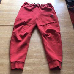 Brand new Nike tech fleece joggers pants sweats red men's small S for Sale in El Cajon, CA