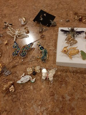 Bulk Brooches at $60 firm. READ AD. (Damascene Beetle online is $25 Alone. You get All for $60). for Sale in Albuquerque, NM