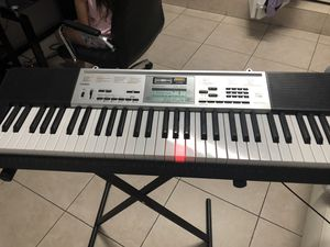 Casio Electronic Musical Instrument. LK-260 61 Lighted-Key Portable Arranger Keyboard for Sale in Miami, FL