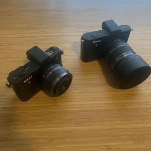 2 Nikon V1 Cameras for Sale in Seattle, WA
