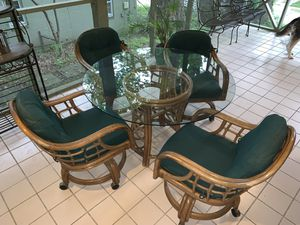 Round glass top table and four bamboo chairs for Sale in Arlington, VA