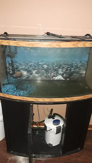 50 gallon fish tank , comes with 100 gallon filter , heater , stand , fan , and LED light. for Sale in Wichita, KS