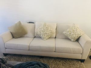 White comfortable couch+ottoman from Living Spaces for Sale in Laguna Beach, CA