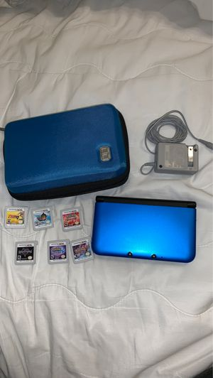 Nintendo 3DS XL with charger, case and games for Sale in San Antonio, TX