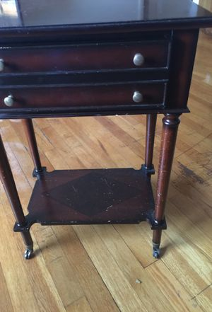 Red wood end table on wheels for Sale in Columbus, OH