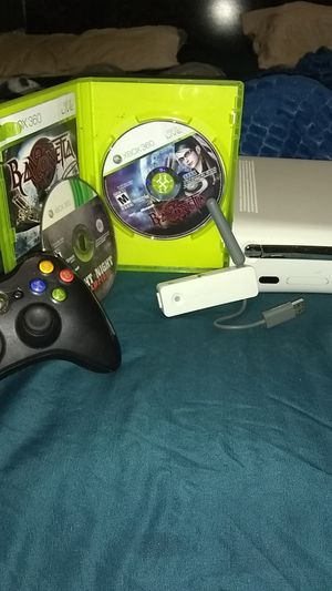 Xbox 360 with network adapter one wireless remote control and 2 video games for Sale in St. Louis, MO