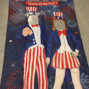 Flag/Banner With Holes In Faces Of Both People For Pictures for Sale in Fort Myers Beach, FL