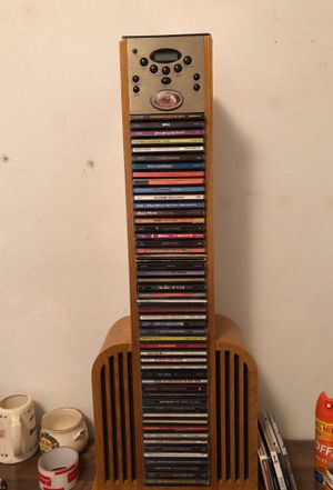 CD player tower with cds for Sale in Mansfield, TX