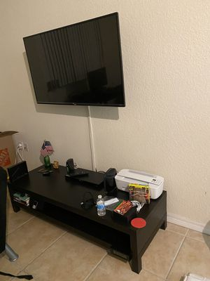 Ikea tv stand low black color for Sale in Coral Gables, FL