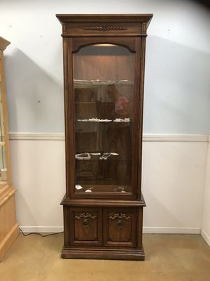 Lockable curio cabinet with storage and key. for Sale in Temecula, CA
