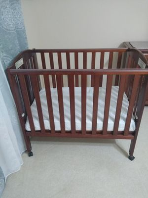 Foldable small baby crib with wheels with new organic mattress. for Sale in Nashville, TN