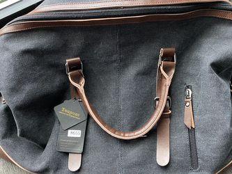 Fashionable Duffle Bag With Tags for Sale in Arlington,  VA