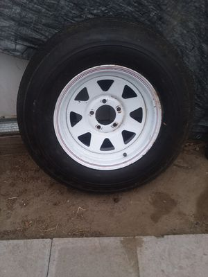 Trailer. Wheel size 14 x 6 wide. 5 lug on 4.50. Bolt pattern with. Trailer. Tire. In good shape. Good. For. Spare tire for Sale in Commerce, CA