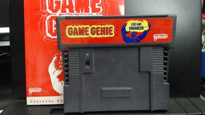 GAME GENIE - (Super Nintendo, SNES) - Cartridge and Manual. CHEAT CODES - UNLOCK EVERYTHING - GAMESHARK - ACTION REPLAY for Sale in Lake Elsinore, CA