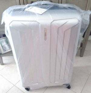 Elegant Suitcases,3 diferent sizes brand new, never used color silver has lock with conbination..... for Sale in Lynwood, CA