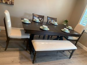 Amber finish dining table with oatmeal fabric chairs and bench for Sale in Danville, CA