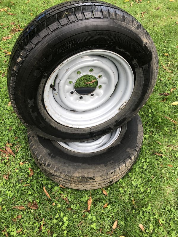 Two - 3/4 ton ford tires and rims. 265/75/16 plus other sizes and truck parts