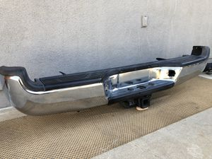 Toyota Tacoma complete rear bumper with tow hitch in great conditions no no damage OEM original Tacoma parts fits 2005 - 2015 for Sale in San Marcos, CA