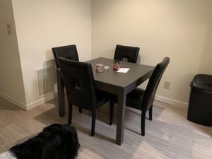 Table and leather chairs for Sale in Manassas, VA